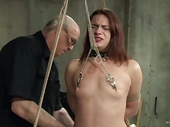 Naughty pervert tied up a sexy redhead chick together with tortures her